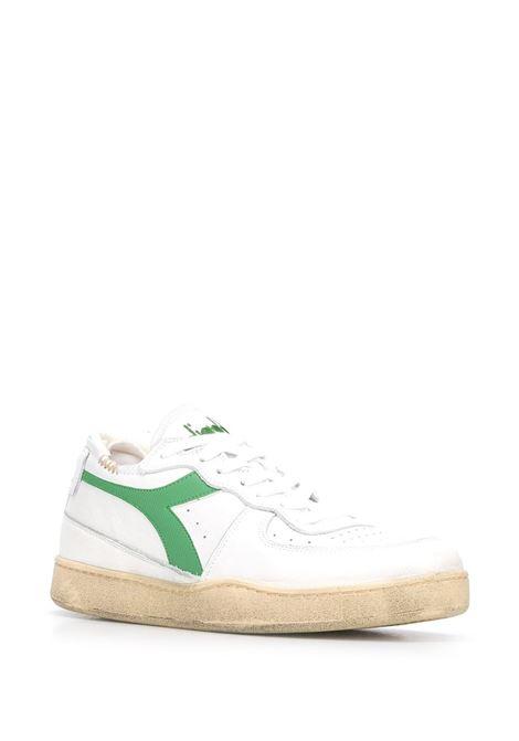 White leather low top sneakers featuring green Diadora logo to the side DIADORA |  | 176282-MI BASKET ROW CUTC8451