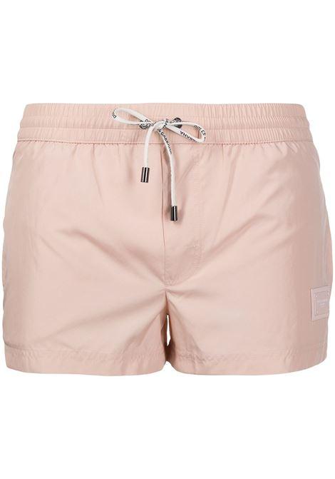 Pale pink swim shorts featuring Dolce & Gabbana logo patch DOLCE & GABBANA |  | M4B11T-FUSFWM0121