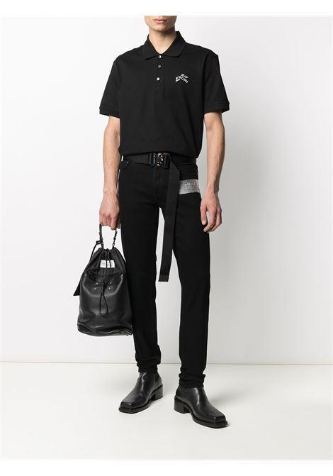 Polo nera in cotone con logo Givenchy bianco ricamato GIVENCHY | Polo | BM71173006001