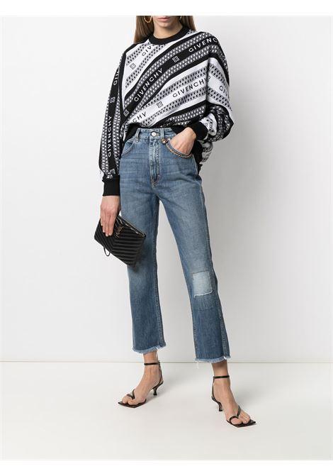 Pullover in lana nera e bianca con logo Givenchy lavorato a intarsio diagonale GIVENCHY | Maglieria | BW90CE4Z7J004