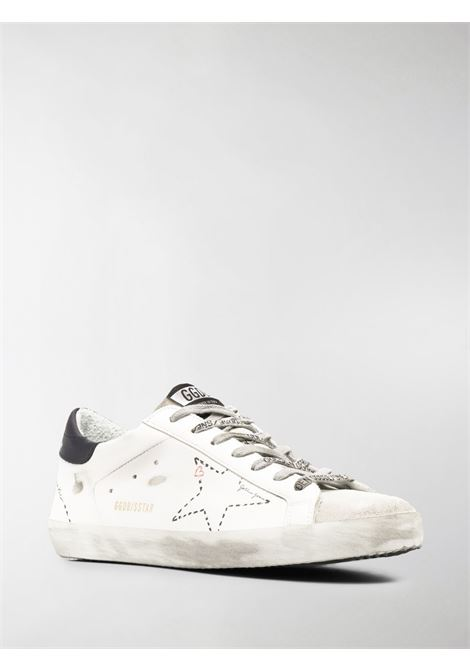 White leather Superstar lace-up sneakers featuring distressed effect and white perforated star to the side GOLDEN GOOSE |  | GMF00101-F00012410278