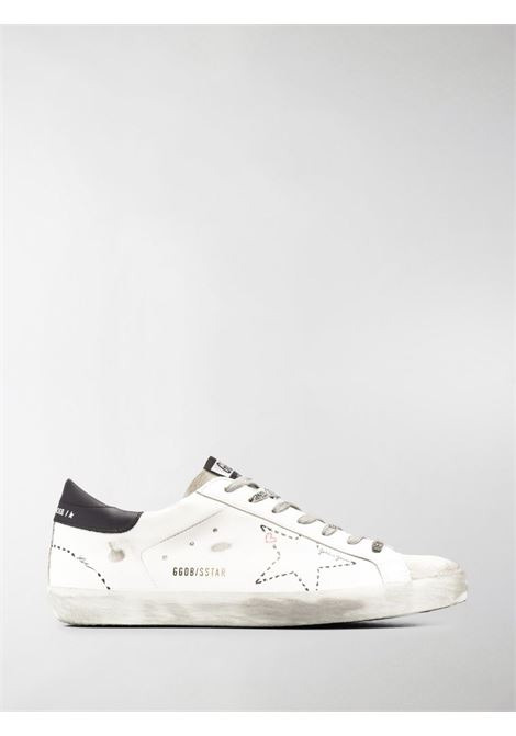 Sneaker Superstar in pelle bianca effetto consumato con stella bianca traforata sul lato GOLDEN GOOSE | Sneakers | GMF00101-F00012410278