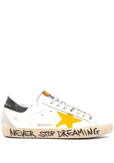 Sneakers basse Superstar in pelle bianca con graffiti neri Never Stop Dreaming sulla suola laterale GOLDEN GOOSE | Sneakers | GMF00102-F00061310343