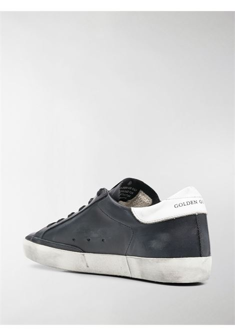 Black and white leather Superstar sneakers featuring signature white star patch  GOLDEN GOOSE |  | GWF00101-F00032180203