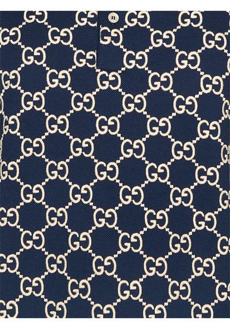 Polo a maniche corte in cotone elasticizzato blu con stampa GG Supreme GUCCI | Polo | 598956-XJB0U4115