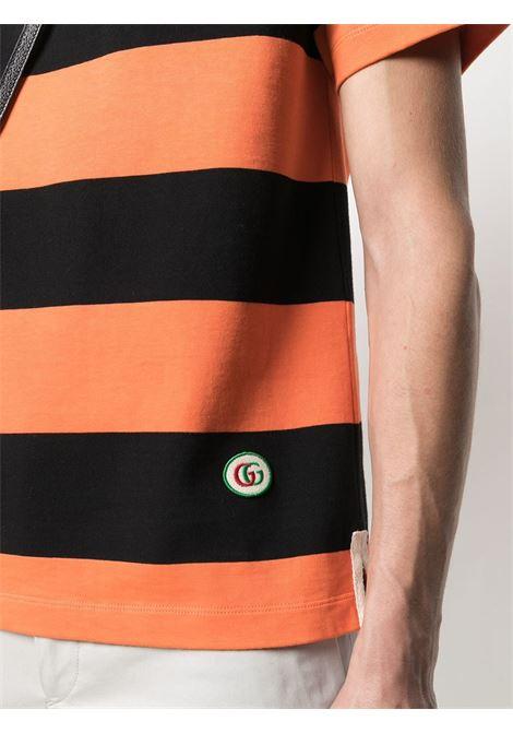 Polo a righe orizzontali in cotone arancione e nero GUCCI | Polo | 645251-XJC6F7252