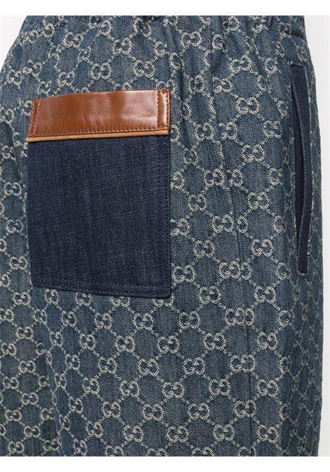 Shorts in denim di cotone biologico eco-lavato blu con stampa GG Gucci Supreme GUCCI | Bermuda | 649093-XDBK14266