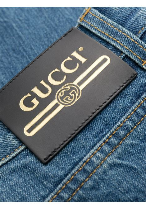 Jeans cropped in cotone blu con fondo a campana Gucci x Disney Collection GUCCI | Jeans | 651458-XDBKO4447