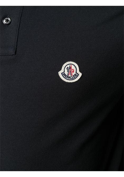 Polo in cotone nera con logo Moncler e colletto a righe MONCLER | Polo | 8A706-00-84556773