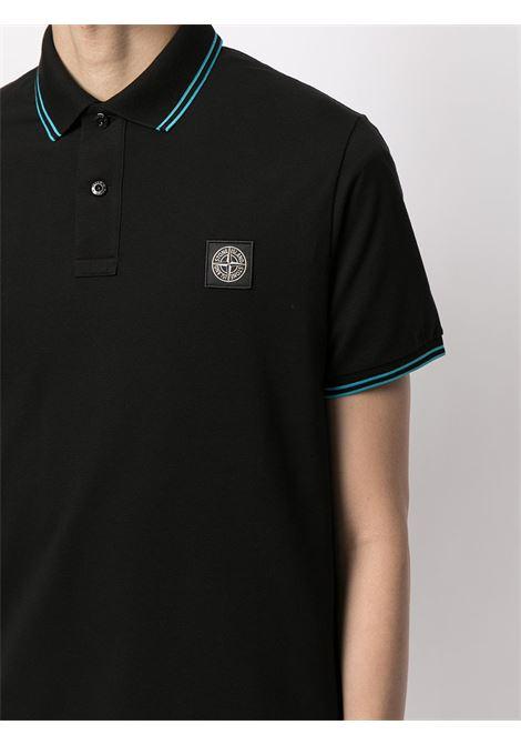 Polo nera in cotone con patch logo Stone Island e dettagli azzurri STONE ISLAND | Polo | 101522S18V0029
