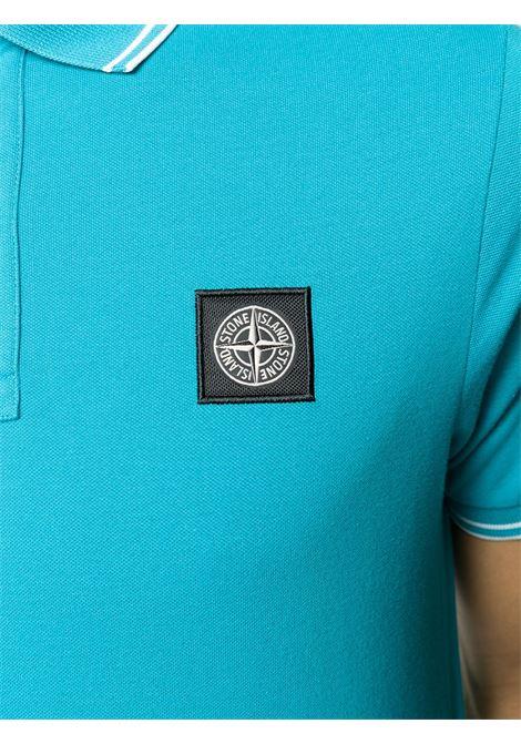 Polo azzurra in cotone con patch logo Stone Island e dettagli bianchi STONE ISLAND | Polo | 101522S18V0042
