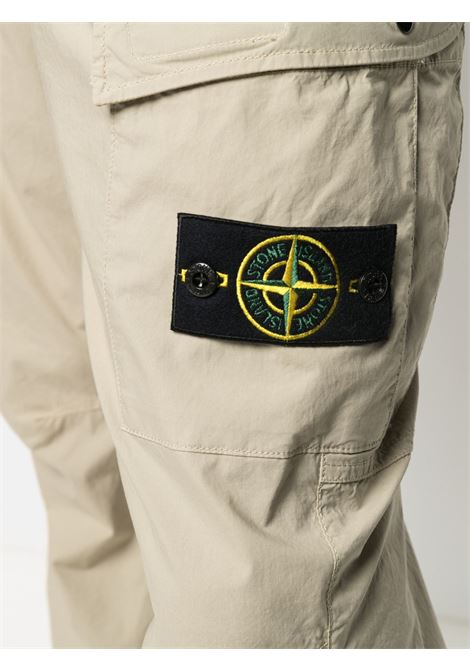 sand stretch cargo trousers featuring Stone Island logo patch to the side STONE ISLAND |  | 741531303V0095