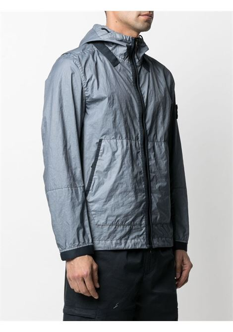 Blue jacket featuring Stone Island logo patch at the sleeve STONE ISLAND |  | 741540523V0046