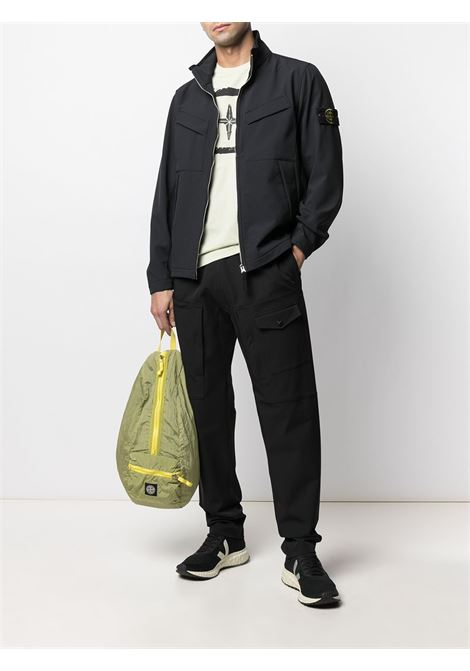 Black jacket featuring Stone Island logo patch at the shoulder STONE ISLAND |  | 741540827V0020