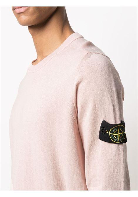 Maglia girocollo in cotone color blush con logo Stone Island sulle maniche STONE ISLAND   Maglieria   7415532B9V0082