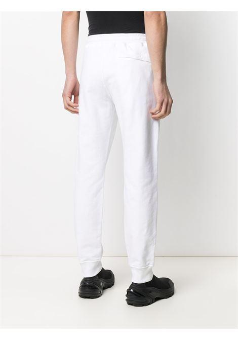 Pantaloni sportivi in cotone bianco STONE ISLAND | Pantaloni | 741564551V0001