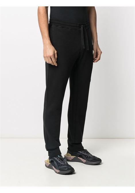 Pantalone jogging in felpa di cotone nero con elastico in vita STONE ISLAND | Pantaloni | 741564551V0029
