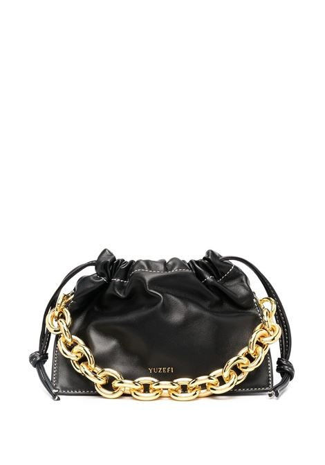 Black leather Mini Bom crossbody bag featuring single gold chain-link top handle YUZEFI |  | MINI BOM-YUZCO-HB-MB00