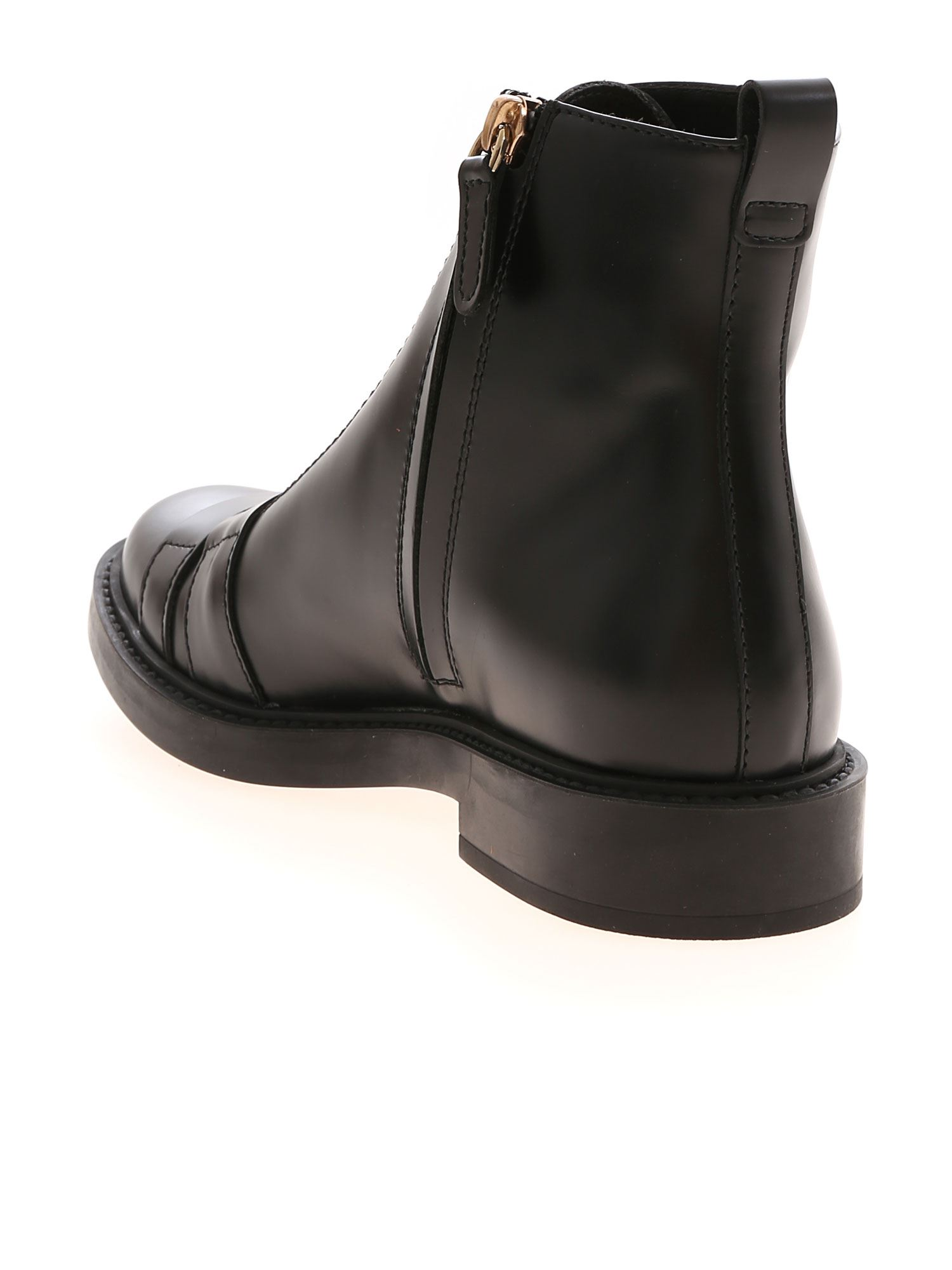 LOW BLACK ANKLE BOOTS FEATURING GOLDEN BUCKLES TOD