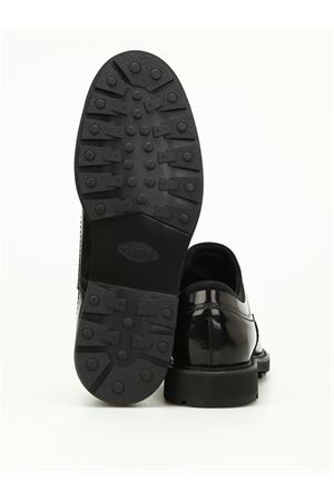Brushed leather and scuba slip-ons TOD