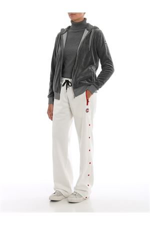 White track pants with side snaps