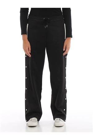 Black track pants with side snaps