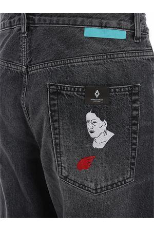 Jeans con risvolti tartan MARCELO BURLON | 24 | CMYA017E19B340981001