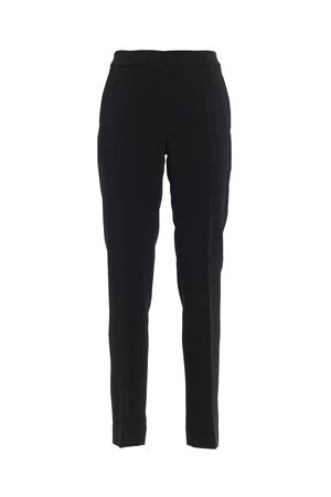Black slim fit trousers in viscose with side pockets and one on the back closed by button. MOSCHINO | 20000005 | 03095425A0555