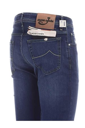 BEIGE LOGO FADED JEANS IN BLUE