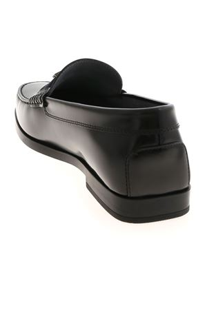 T LOGO LOAFERS IN BLACK TOD