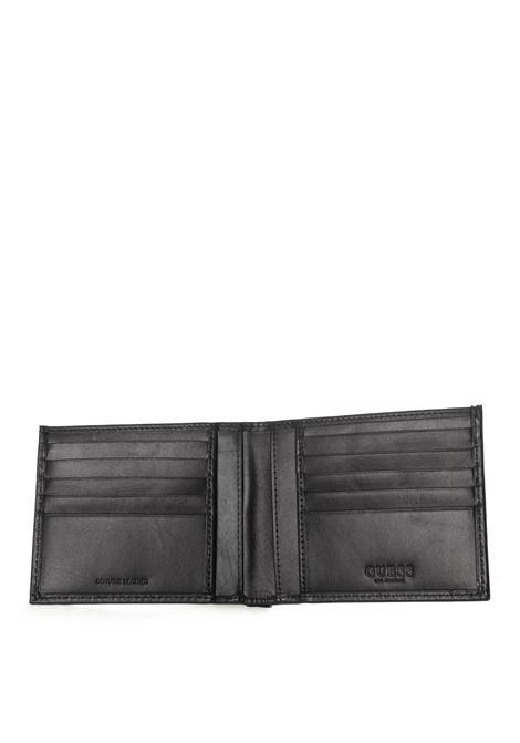Guess portafoglio reilly flat nero GUESS | Portafogli | SMREILREILLY FLAT-BLA