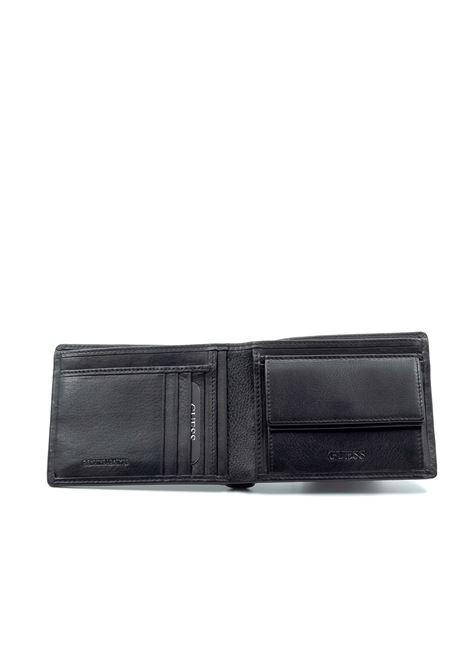 Guess portafoglio tyler nero  GUESS | Portafogli | SM2661TYLER-BLA