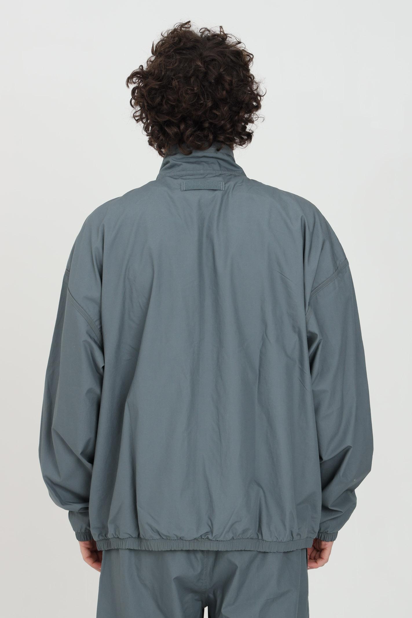Giacca a vento uomo blue adidas con zip integrale ADIDAS | Giubbotti | GN3327.