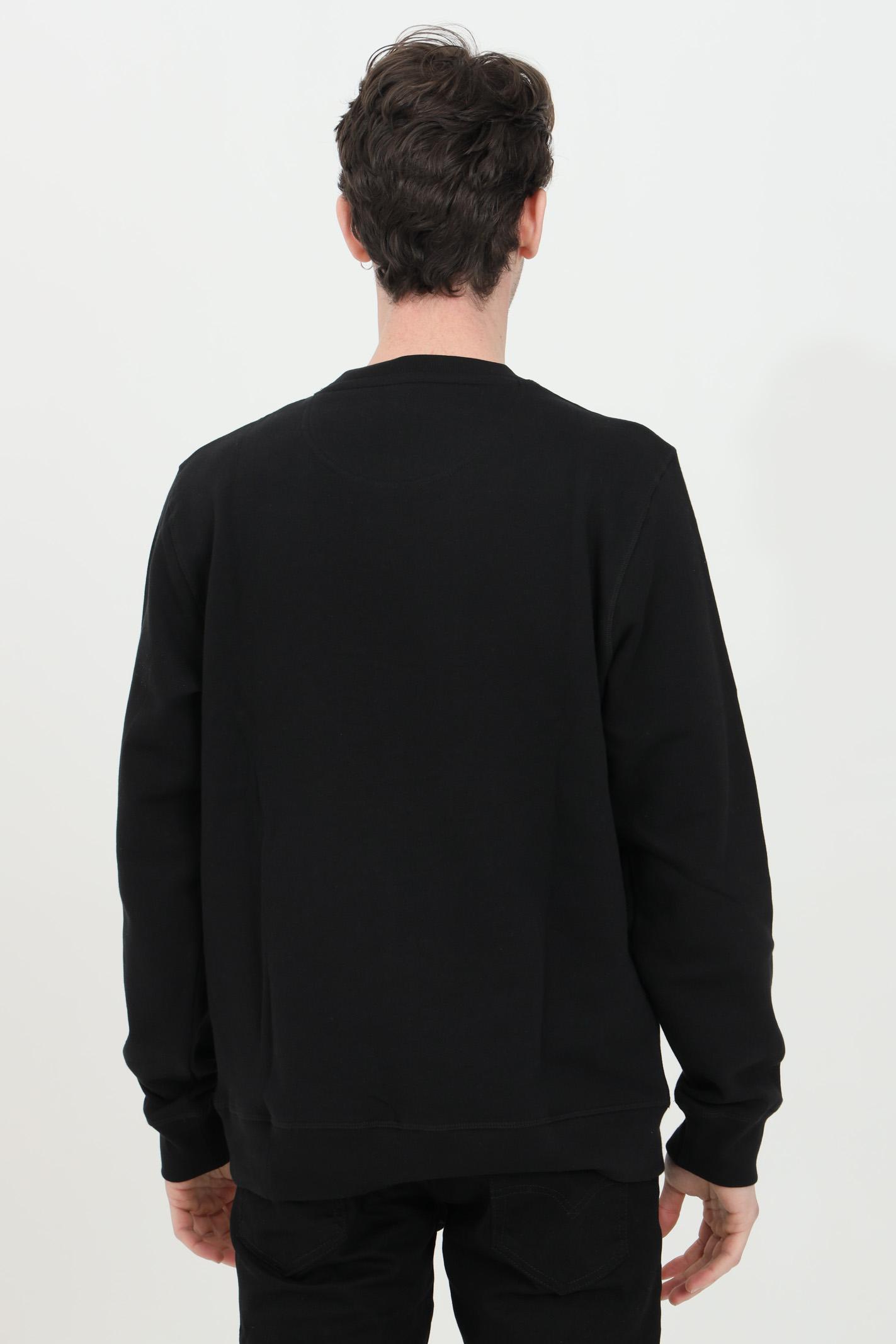 Black crew neck sweatshirt with international logo print on the front. Barbour BARbour | Sweatshirt | MOL0156-MOLBK31