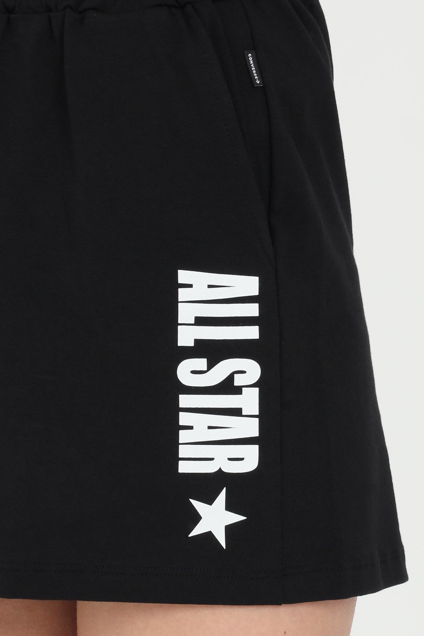 Shorts all star side w donna nero Converse casual con elastico in vita e tasche laterali. Logo a contrasto. CONVERSE   Shorts   10022589-A03A03