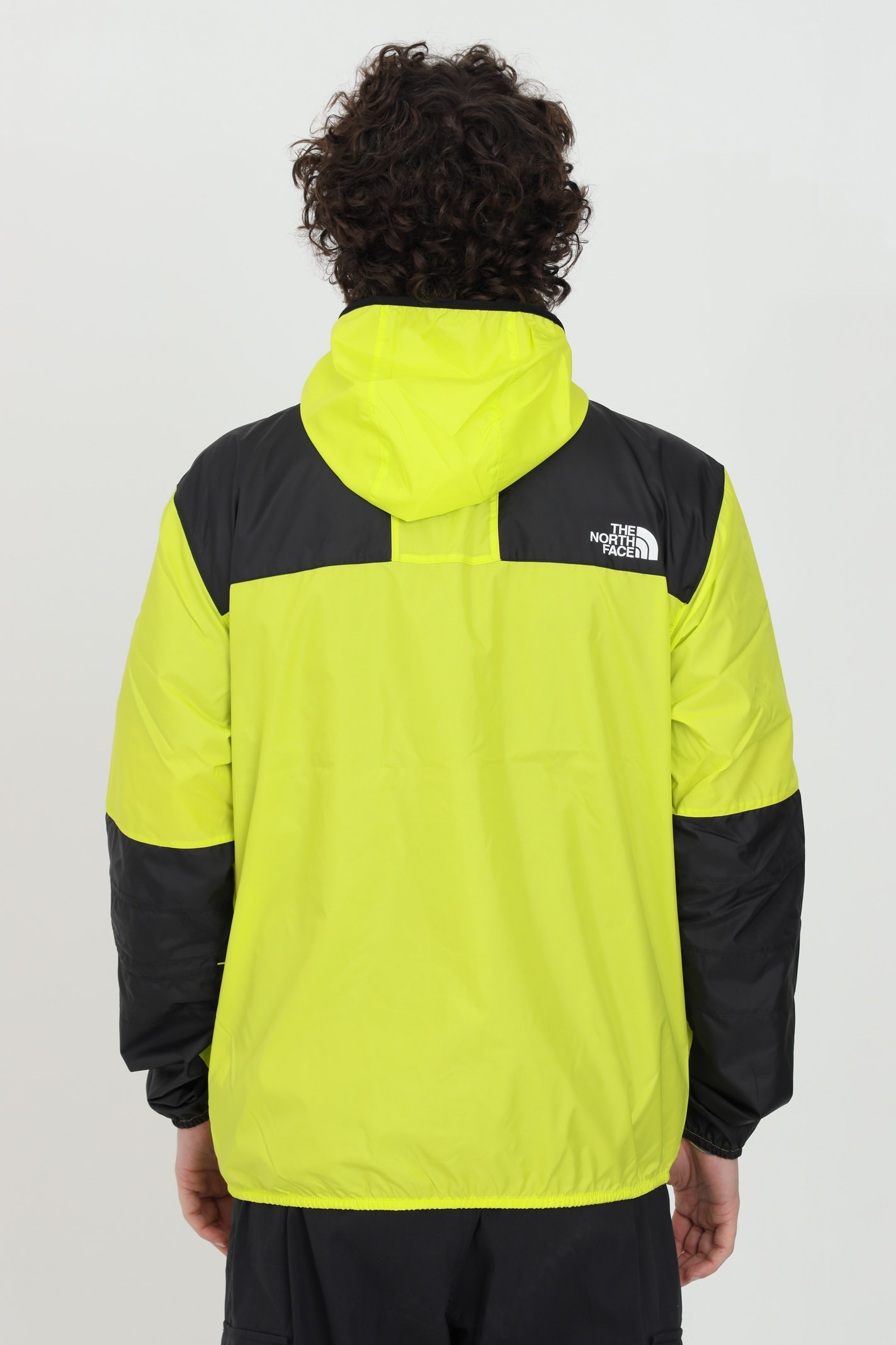 Yellow wind jacket with elastic cuffs and bottom, pockets with zip. Front closure with full lenght zip. The north face  THE NORTH FACE | Jacket | NF00CH37JE31JE31