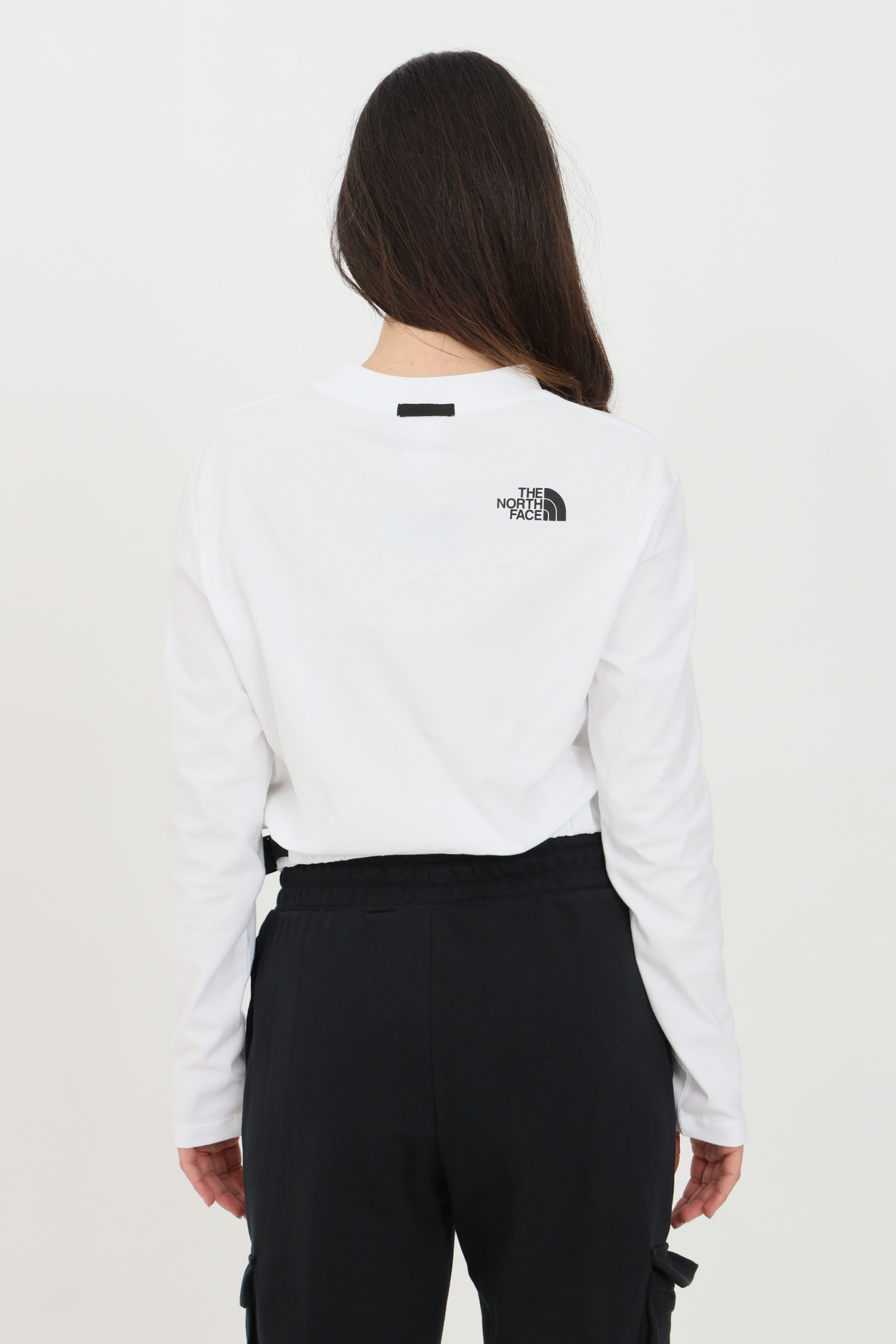 Felpa donna bianco the north face girocollo in tinta unita con patch logo frontale, taglio corto e coulisse sul fondo THE NORTH FACE | Felpe | NF0A557SFN41FN41