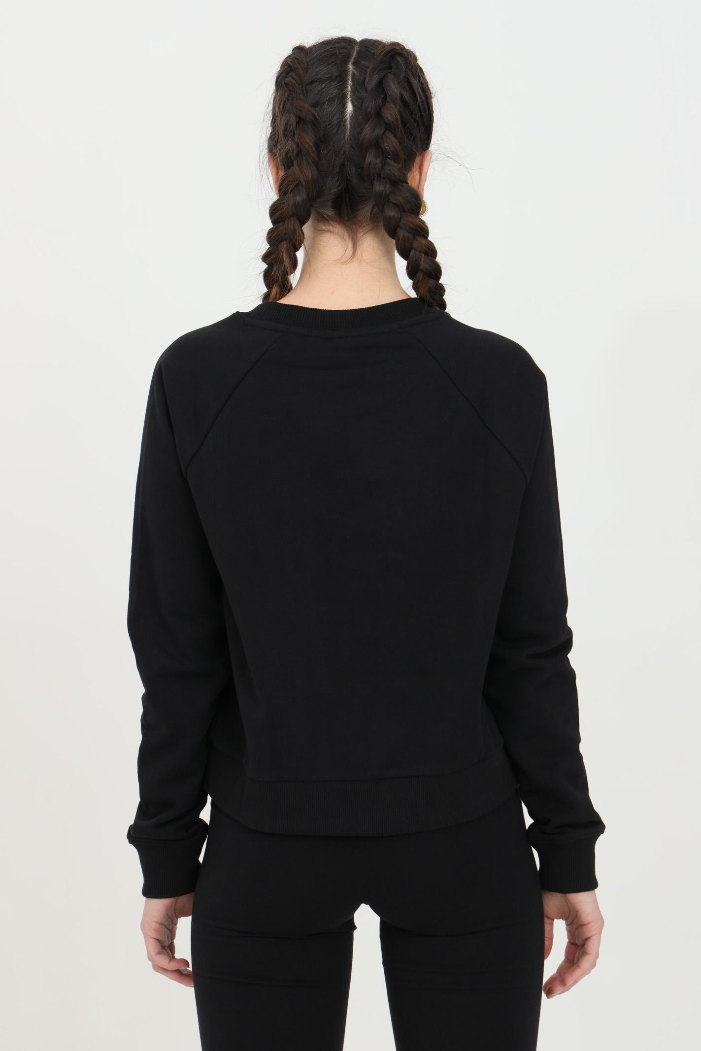 Felpa donna nero vans girocollo in tinta unita con logo frontale a contrasto, fondo e polsini elastici. Modello comodo VANS   Felpe   VN0A47THBLK1BLK1