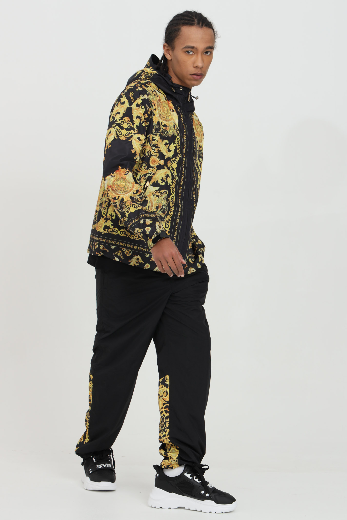 Black jacket with zip and hood and baroque print, elastic cuffs and bottom. Brand: Versace jeans couture VERSACE JEANS COUTURE | Jacket | C1GWA9A825188899