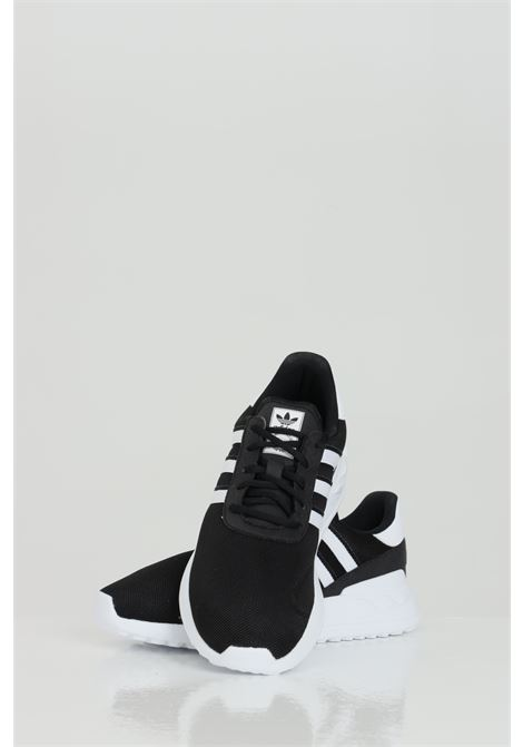 Black La Trainer Lite C sneakers in solid color with contrasting side bands, closure with laces. Baby model. Brand: Adidas ADIDAS | Sneakers | FW5842BLACK/FTWWHT