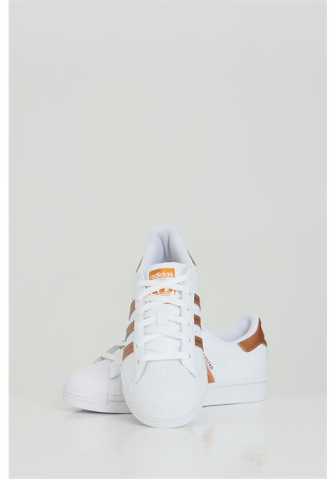 Superstar Sneakers with bronze inserts. ADIDAS | Sneakers | FX7484FTWWHT/COPPMT