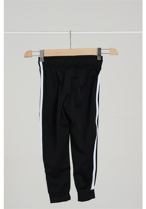 Black track sst trousers with embroidered logo and contrasting side bands. Baby model. Brand: Adidas ADIDAS | Pants | GE1997BLACK/WHITE