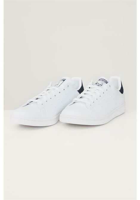 White unisex stan smith sneakers by adidas ADIDAS   Sneakers   FX5501.