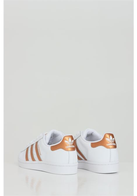 White women's superstar sneakers by adidas with bronze inserts ADIDAS | Sneakers | FX7484FTWWHT/COPPMT