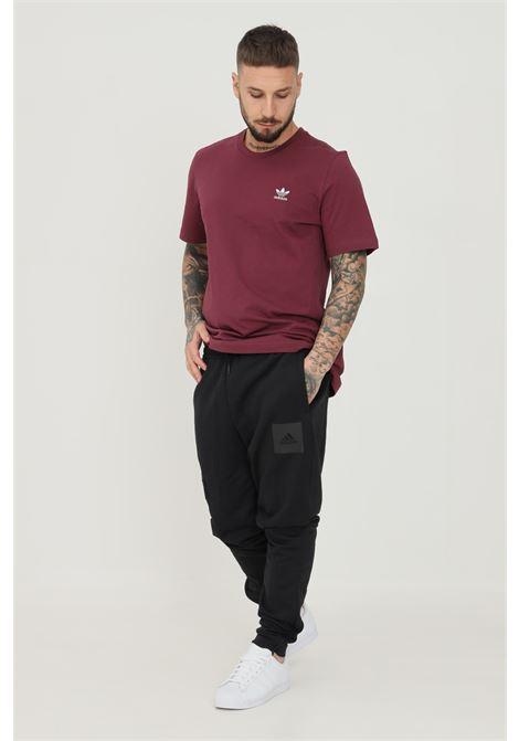 Pantaloni essentials fleece uomo nero adidas ADIDAS | Pantaloni | GU1802.