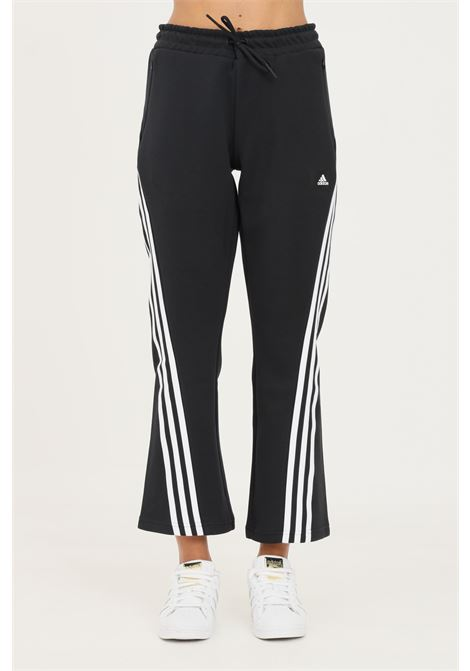 Black women's adidas sportswear future icons 3-stripes flare trousers ADIDAS | Pants | GU9698.