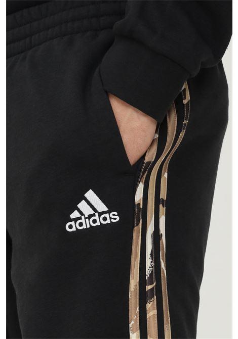 Pantaloni essentials fleece camo-print uomo nero adidas ADIDAS | Pantaloni | GV2125.