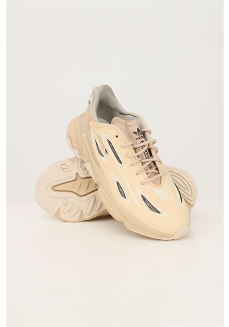 Beige women's ozweego celox sneakers by adidas  ADIDAS | Sneakers | GZ7280.