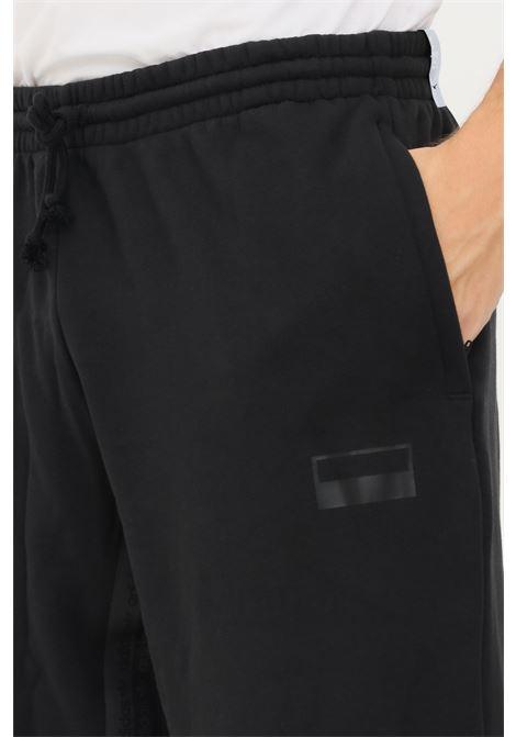 Pantaloni uomo nero adidas con coulisse in vita ADIDAS | Pantaloni | H11486.