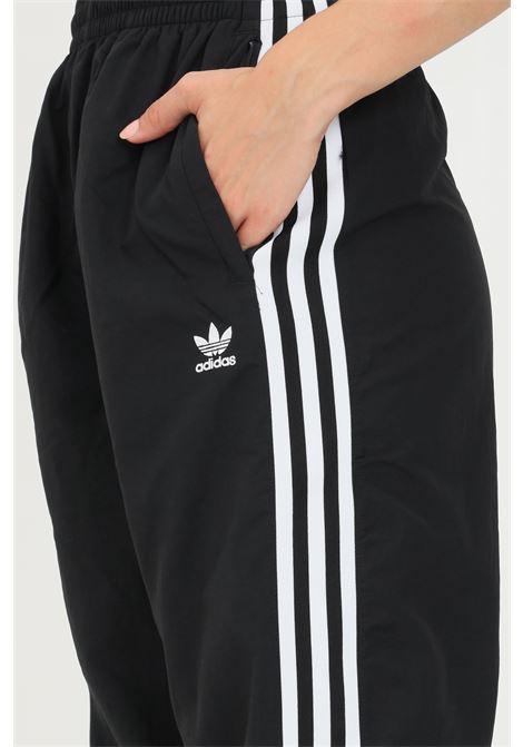 Pantaloni track pants adicolor classics lock-up donna nero adidas sport ADIDAS | Pantaloni | H20547.